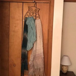 3 scarves and scarf hanger.
